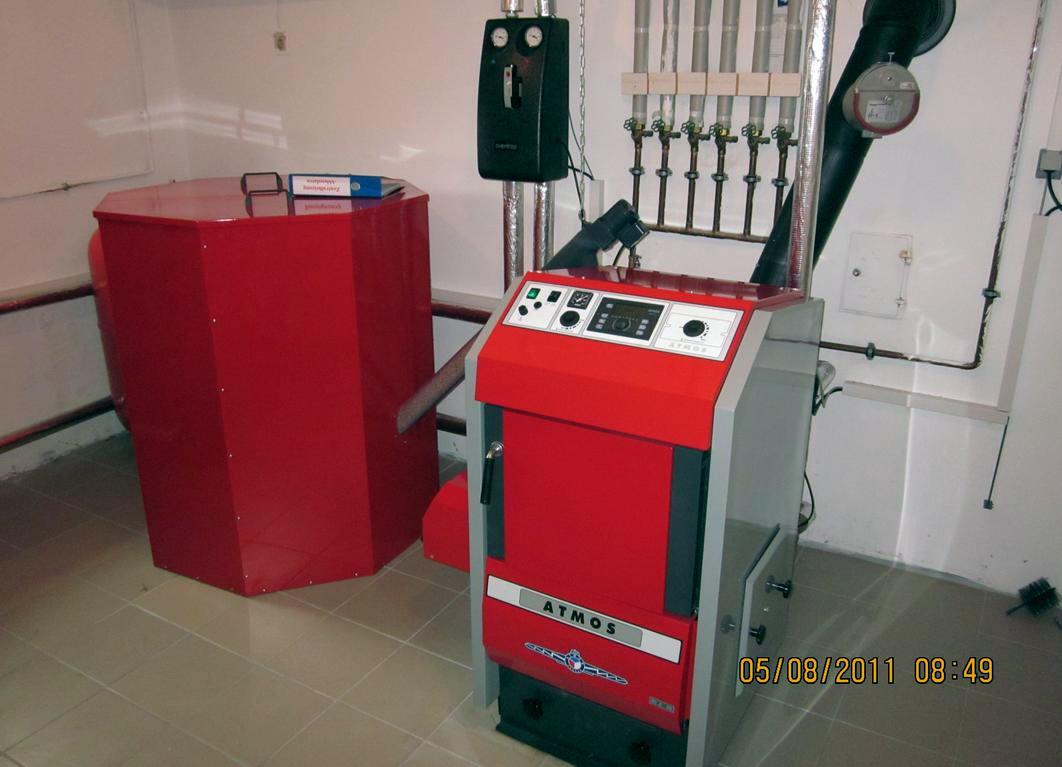 ATMOS P25 mit 1000 Liter Pelletsilo, Schnecke, Brenner A25 und Regumat M3-180 Ausdehnungsgefäß ACD01 Killus-Technik.de