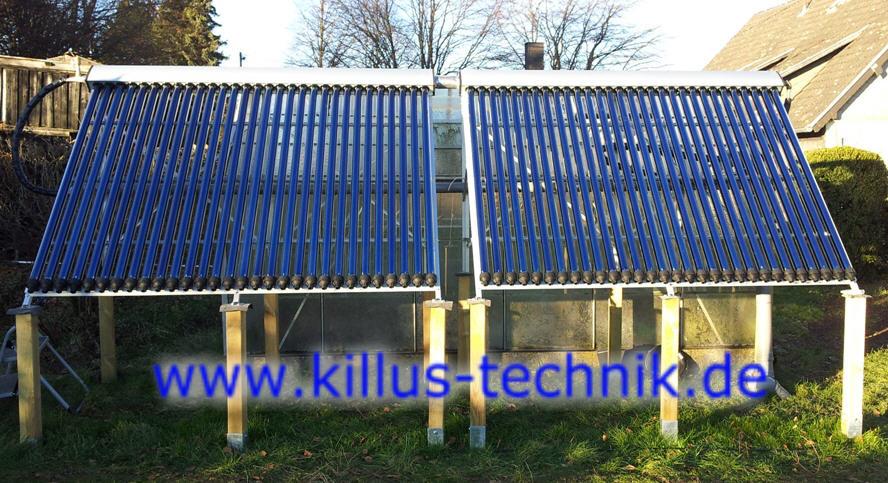 Vakuum-Röhren-Solaranlage 2 x 30 Röhren im Freien vor einem Gewächshaus Killus-Technik.de